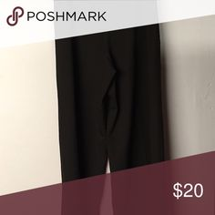 Classic black pants NWOT. These classic black pants are super comfy and perfect for a day in the office or a night on the town. Features a very wide pant leg and wider waist with side zipper. From a nonsmoking home. Larry Levine Pants Wide Leg