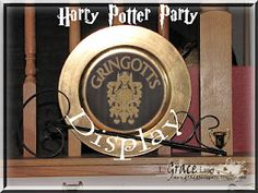 Gringotts Bank Sign for display at Harry Potter Birthday party used 450 Quick Dry to adhere the printed cardstock to the plastic $1 store plastic gold charger.