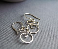 """This swirl earring is one of my most popular designs! Free formed and hammered for the perfect balance of delicate and textured. 1.25"""" from top to bottom 14K gold filled wire is used to make this ligh"""