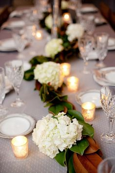 Magnolia Leaves and Hydrangeas Together--could be good for bar decoration? or incorporate magnolia leaves in hydrangea arrangement Magnolia Garland, Magnolia Table, Magnolia Leaves, Reception Table, Wedding Table, Wedding Ideas, Wedding Story, Reception Ideas, Wedding Reception