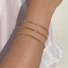 Our Figaro chain bracelet is a gold staple to wear alone or stack with our other gold filled bracelets. Our 14k gold-filled jewelry is plated with real 14k gold over brass and is water and tarnish resistant. 14k gold-filled jewelry is a great alternative to solid gold, and can be worn by people with sensitive skin. The color will not tarnish but recommend to keep away from liquids, perfumes and lotions. BUY 2, GET 1 FREE. Coupon applied at checkout. - 14k gold-filled- Chain width: 3.5 mm. - Chai Italian Gold Jewelry, Real Gold Jewelry, Gold Jewelry Simple, Solid Gold Jewelry, Gold Filled Jewelry, Gold Filled Chain, Dainty Bracelets, Layered Bracelets, Stacking Bracelets