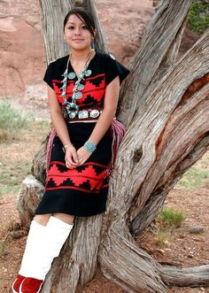 Young Navajo Women in traditional Navajo rug dress, mocasin wraps and turquoise jewelry.