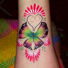 Holiday Butterfly arm painting by Glitter Goose. Face paint.