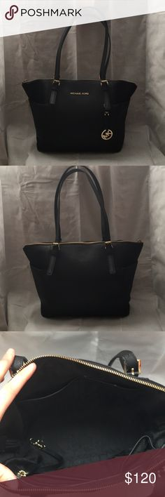 Michael Kors handbag Black medium sized handbag with a top zipper. Gold accents. Michael Kors Bags Shoulder Bags