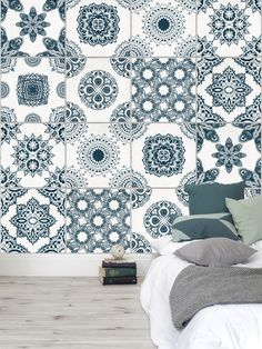 It's all in the details. This tile effect wallpaper design is brimming with intricate shapes and patterns. The teal colours look great with this neutral bedroom setting.