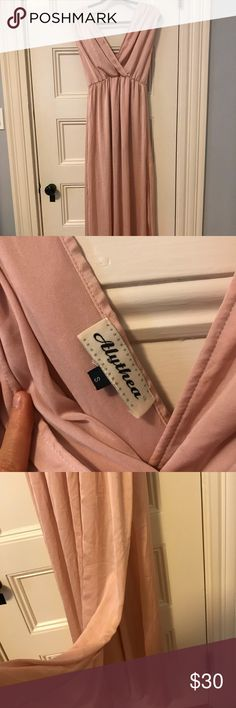 Soft Blush Pink Maxi Dress Only worn once! Bought at a boutique to wear for my birthday dinner last year. The most perfect soft pink ever, silky feel and a light slip underneath. It has a slit in both sides, so walking is breezy. I'm 5'6 and it hits just about at my ankles. I'm a solid medium but Small fit well. Alythea Dresses Maxi