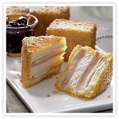 """monte cristo sandwich """"Slices of ham, turkey, and Swiss cheese are layered between soft slices of bread, then deep fried with a crispy crust of panko bread crumbs in this updated Turkey Sandwiches, Wrap Sandwiches, Monte Cristo Sandwich, Delicious Sandwiches, Restaurant Recipes, Sandwich Recipes, Food For Thought, Food To Make, Yummy Food"""