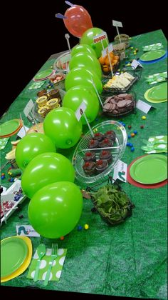 """Gather your favorite treats and snacks from """"The Very Hungry Caterpillar,"""" place them around a caterpillar made from 9 green balloons and one red balloon for the head! #TheVeryHungryCaterpillar #EricCarle"""