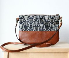 brown leather printed cross body bag. Very cute pattern. Did i mention i love brown bags?