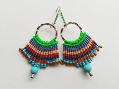 Delicate work of micro macramé, colorful and lightweight handmade earrings, hand knotted with polyester waxed thread. Attractive colors and very charming! Without hooks, these earrings measure 6 cm/2,36 inches and 8 cm /3,14 including hooks. One of a kind, totally handmade and ready