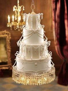 Wedding cake inspired by a vintage chandelier & this cake floats--it's suspended from the ceiling! Now that's elegant! #weddingcakes