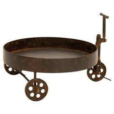 """Bring heirloom-worthy style to your home with this chic design, artfully crafted for lasting appeal.   Product: Decorative trolley   Construction Material: Metal      Color: Rust     Dimensions: 12"""" H x 18"""" W x 16"""" D"""