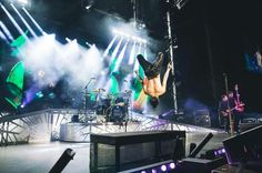"Brendon Urie doing a backflip on stage in Milwaukee, WI, during the 2016 ""Death of a Bachelor"" tour."