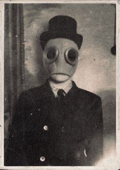 odd. oddities. masks. scary. creepy. weird. history. vintage. culture. entertainment. black and white photographs. vintage photographs. vint...