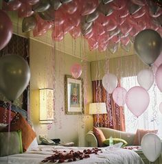 Love this idea for the honeymoon suite post-wedding - tons of balloons filling the room with flower petals on the bed! You can do it in your...