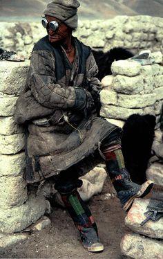 A Tibetan nomad.འབྲོག་པ༏ (Drokpa).  He's got an interesting footwear on; sort of like a sneaker/sompa (traditional Tibetan boots).