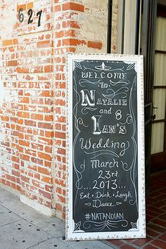 a old looking brick wall a black board to invite guests in the venue. To keep it simple and beautiful.