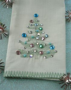 Tree tea towel - cute idea - take Christmas tea towels or napkins and add embellishments. (Might come off in the wash though)