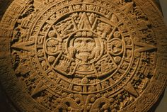 ✮ A closeup of the center of the 20-ton Aztec Sun Stone which depicts the sun god and the four epochs of the creation and destruction of the universe in Aztec mythology.  Other symbols represent the 20 days of the Aztec month, the source o f the popular name of Calendar Stone