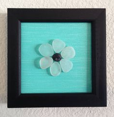 Sea glass flower with a pebble center, sea glass collected from a beach on the central coast of California. Acrylic painting on a framed 4 x