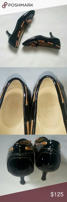 Stuart Weitzman Black Kitten Heels Stuart Weitzman Black kitten heels with brown leather Women's size 8 (the shoes do not say the size, but when compared to other shoes they fit a size 8) Like new Stuart Weitzman Shoes Heels