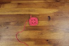 This free crochet pillow pattern with a modern heart makes a perfect DIY gift idea. Square cushion pattern includes written instructions, photo tutorial and a chart. | MakeAndDoCrew.com