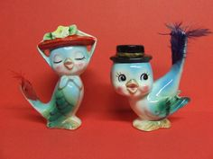 Vintage bluebird salt and pepper pair.  their tails have actual feathers attached.