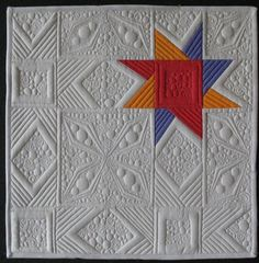quilt as desired identical blocks + different quilters = stitchy madness! Riddle us this Q-bies:...