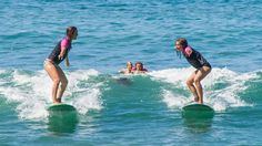 Two friends surfing - Surf camp in Mexico - KILROY