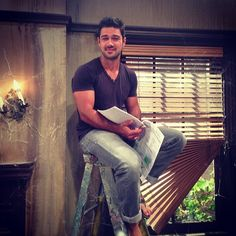 Ryan Paevey.. Just sitting on a ladder.. With his script in hand.. (Haha)