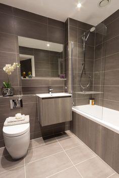 Family bathroom designs a modern central apartment bathroom design featuring neutral grey tiles luxurious white porcelain small family bathroom design ideas Apartment Bathroom Design, Bathroom Tile Designs, Bathroom Design Small, Bathroom Renos, Bathroom Interior, Best Bathroom Vanities, White Bathroom, Modern Bathroom Lighting, Toilet Design