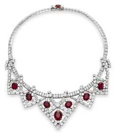 A ruby-and-diamond necklace, by Cartier, gift from Mike Todd    Nothing says perfect red like Burmese rubies. And Elizabeth wore them with fitting perfection.