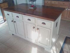 We took a stock builder grade island and turned it into this by adding trim, paint, hardware and a homemade black walnut top. Wrapped the island with x Poplar wood from Home Dep… Kitchen Island Molding, Kitchen Island Makeover, Diy Kitchen Island, Diy Kitchen Cabinets, Painting Kitchen Cabinets, Kitchen Countertops, Kitchen Furniture, New Kitchen, Kitchen Decor