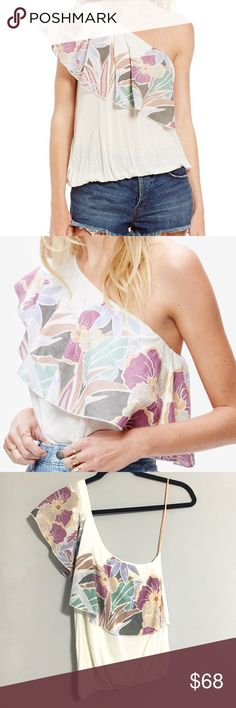 NWT Free People Annka Bubble Top Free People Annka One Shoulder Bubble Top   You'll love the fashionable look and flirty feel of this stylish knit top. Featuring a floral printed ruffle across its one shoulder neckline and a shorter cropped hem, this chic style is a must-have for your collection. Color - Ivory. Size - XS. One shoulder neckline Unlined Machine washable Cotton, lyocell® Free People Tops
