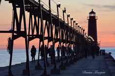 Sunset at the Grand Haven Lighthouse. 100% all natural colors no edits/enhancements #lighthouse #lighthouses #miplayground #LakeshoreLife #grandhaven #grandhavenpier #beach #sand #lakemichigan #greatlakes #lake #water #waves #puremichigan #inspiredbymichigan #photography #visitgrandhaven #fish #fishing #pier #sunset #sunsets #silhouette #dog #dogs #people #shadows #colors @puremittigan @puremichigan @visitgrandhaven by denisem269