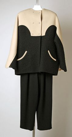 Black wool jumpsuit ensemble (with black and beige wool colorblocked wool jacket), by Geoffrey Beene for Bergdorf Goodman, American, ca. 1995.