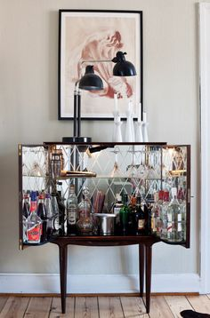 mirrored cabinet  W/ liquor .... double delicious