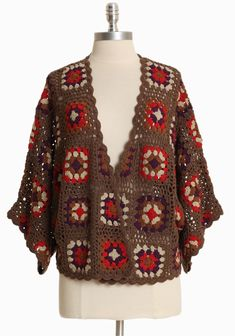 "Vintage Moon Crochet Cardigan 52.99 at shopruche.com. This crocheted cardigan in brown is accented with a charming vintage-inspired pattern, three-quarter length sleeves, and a scalloped trim.  100% Acrylic, Imported, 24"" length from top of shoulder"