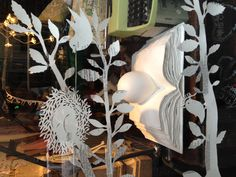 Papercutout nests in And Company's window in Firenze