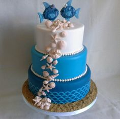 Nautical, fish & shells themed wedding cake created by MJ www.mjscakes.co.nz in sunny Hawkes Bay NZ delivered to lovely home inTwyford Fish Theme, Themed Wedding Cakes, Theme Cakes, Celebration Cakes, Mj, Cake Ideas, Nautical, Shells, Create