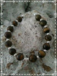baby bracelet https://www.facebook.com/parelsenstrikjes De zoon armband uit de serie TO Armband Pelle   Babyarmband: €16.95  Kinderarmband : €18.95  Gemaakt van de tijgeroog kraal gecombineerd met sterling zilver