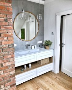 I think that exposed brick looks good in any space! Small Bathroom Sink Cabinet, Bathroom Wall Cabinets White, Narrow Bathroom Storage, Wood Mirror Bathroom, Painting Bathroom Cabinets, White Bathroom, Cream Bathroom, Storage Mirror, Bathroom Small