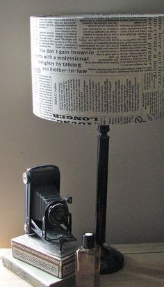 newspaper fabric lampshade by photos from the old lamp shed, via Flickr