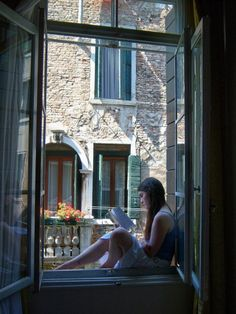 I could be ........Reading on a window ledge in Venice.