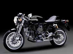 Sad, sick new gearhead desire. 2007 Ducati Sport 1000 Monoposto. I love how stripped down it is compared to most other modern bikes.