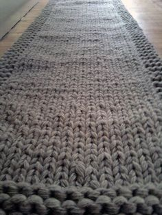 Wonder if I could do something similar for table runners...? Knitted Rug Yarn Runner