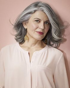 Vibrant make-up with silver hair.