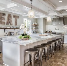 Love The EAT Sign Kitchen Features A Long Island With White And Gray Marble  Countertop. Kitchen With Long Island.