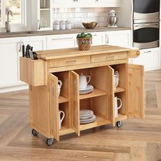 Home Styles 54 in. W Wood Kitchen Cart with Breakfast Bar in Natural at The Home Depot - Mobile Small Kitchen Cart, Kitchen Island Bench, Kitchen Tops, Kitchen Shelves, New Kitchen, Kitchen Islands, Awesome Kitchen, Kitchen Ideas, Moving Kitchen Island