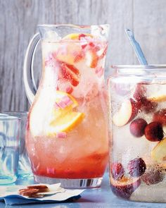"""See the """"Strawberry-Rhubarb Sangria"""" in our gallery. The strawberry-rhubarb duo escapes its typecast role as pie filling to star in a sparkling sangria that will be the hit of your next party. Summer Cocktails, Cocktail Drinks, Fun Drinks, Beverages, Summer Sangria, Party Drinks, Alcoholic Drinks, Rhubarb Recipes, Fruit Recipes"""